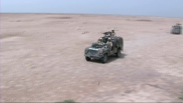 Household Cavalry regiment return from Iraq IRAQ Household Cavalry on patrol in desert area in armoured vehicles