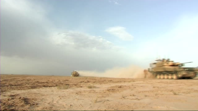 Household Cavalry regiment return from Iraq IRAQ Household Cavalry regiment on patrol in desert area on foot and in tanks