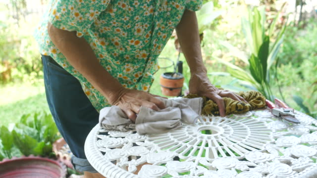 housekeeper  cleaning white table with rag - patio stock videos & royalty-free footage