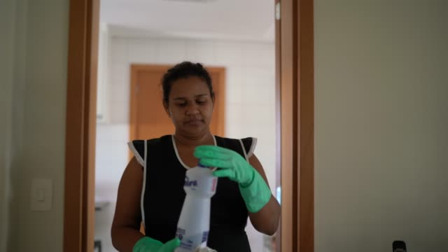 housekeeper with glove cleaning the house - dustman stock videos & royalty-free footage