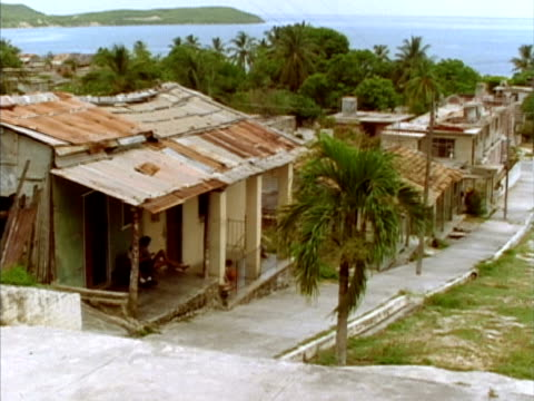 ms, ha, houses along street and harbor, nuevitas, cuba  - palma nana video stock e b–roll