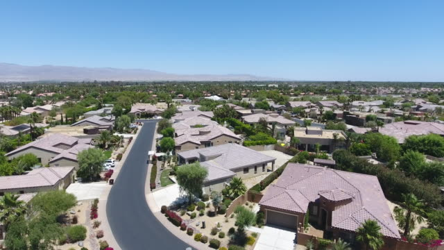 houses and a curvy road in palm springs - palm tree stock videos & royalty-free footage