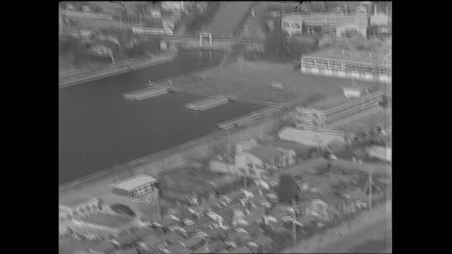 houses and apartment buildings surround the toda olympic boat course / shot at toda city in saitama on october 5 1965 - saitama city stock videos & royalty-free footage