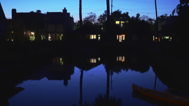 houses and apartments on canal at night - venice california stock videos & royalty-free footage