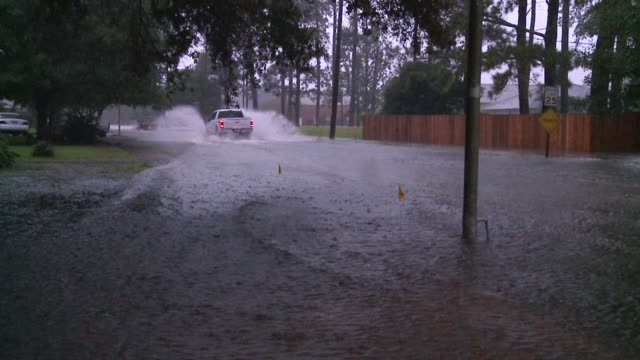 WGNO Houses and Cars PartiallySubmerged During Historic Louisiana Flooding near New Orleans on August 15 2016