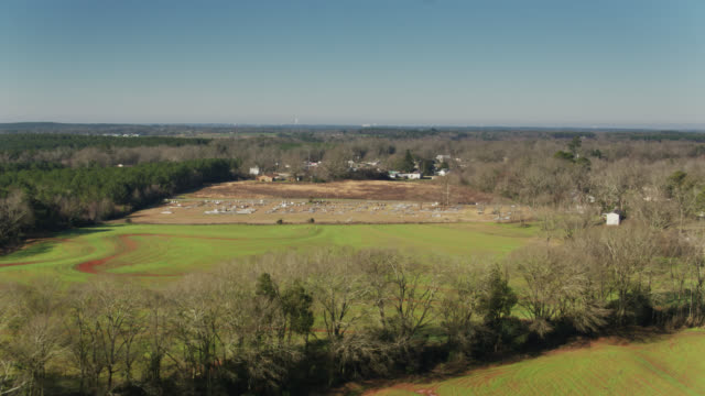 houses and cemetery on the edge of banks, alabama - residential district stock videos & royalty-free footage