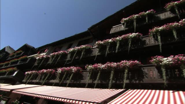Houses and flowers along the main street of Zermatt, Switzerland