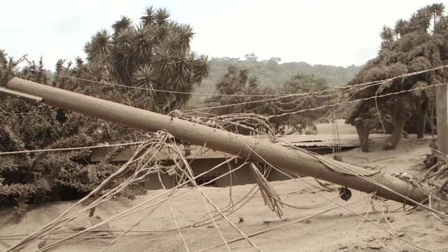 houses and roads buried in volcanic ash in el rodeo guatemala after the devastating fuego volcano eruption - ash stock videos & royalty-free footage