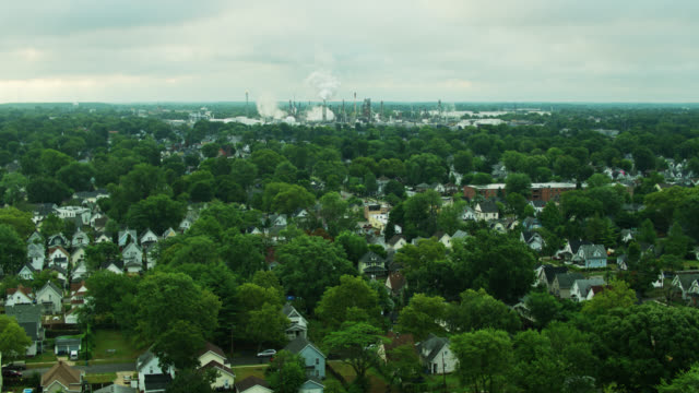 houses beside huge oil refinery in east toledo, ohio - aerial - ohio stock videos & royalty-free footage