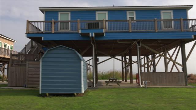 houses built on stilts in low lying holly beach, louisiana - stilt house stock videos & royalty-free footage