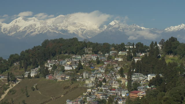 Houses cover a hillside in Darjeeling, India.
