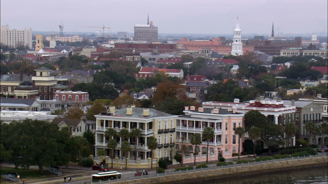houses facing charleston harbour  - aerial view - south carolina,  charleston county,  united states - charleston south carolina stock videos & royalty-free footage
