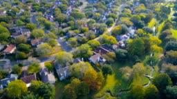 Houses , homes , neighborhood community under golden morning sunlight