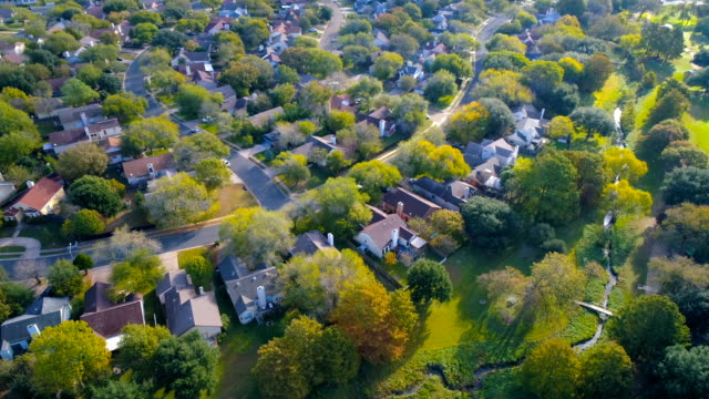 houses , homes , neighborhood community under golden morning sunlight - residential district stock videos & royalty-free footage