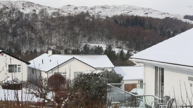 houses in ambleside in the lake district after a heavy overnight fall of snow. - winter stock videos & royalty-free footage