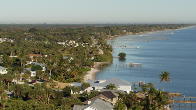 houses in jensen beach, florida - aerial - jetty stock videos & royalty-free footage