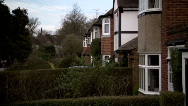 houses in rayners lane, london have a uniformed look. available in hd. - suburban stock videos & royalty-free footage