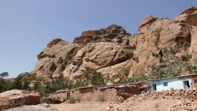 houses in the hill, senafe, eritrea on february 23, 2013 in senafe, eritrea. - アフリカの角点の映像素材/bロール