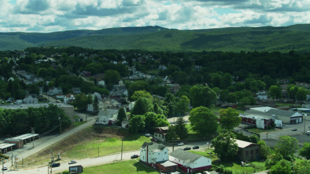 houses in uniontown, pennsylvania with forested hills beyond - drone - pennsylvania stock videos & royalty-free footage