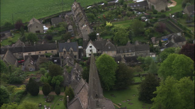 houses line city streets in cotswold, england. - gloucestershire stock videos and b-roll footage