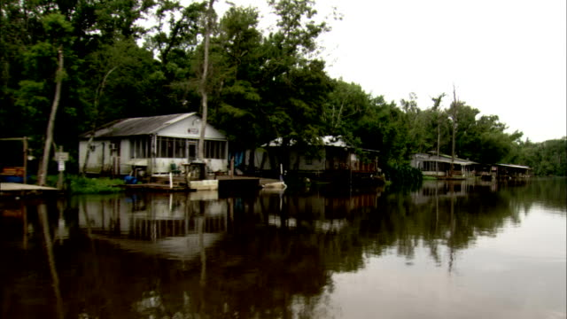 Houses line the swamps of Louisiana. Available in HD.