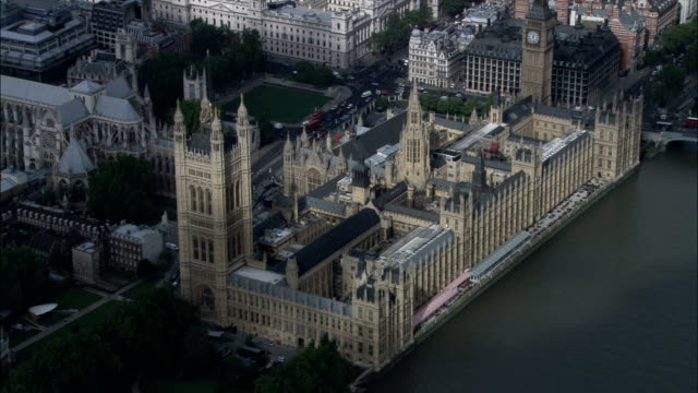houses of parliament  - aerial view - england, greater london, city of westminster, united kingdom - parliament building stock videos & royalty-free footage