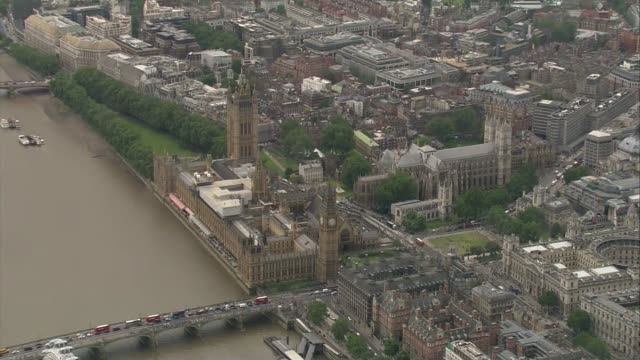 houses of parliament aerials; england: london: westminster: ext air views houses of parliament, parliament square, westminster cathedral - westminster cathedral stock videos & royalty-free footage