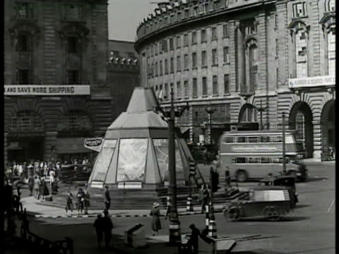 houses of parliament amp clock tower w/ thames river fg piccadilly circus people traffic movie theater marquees 'our vines have tender grapes'... - 1949 stock videos and b-roll footage