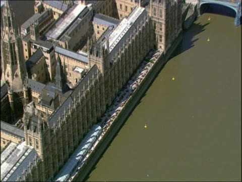 houses of parliament beside the river thames - houses of parliament london stock videos & royalty-free footage