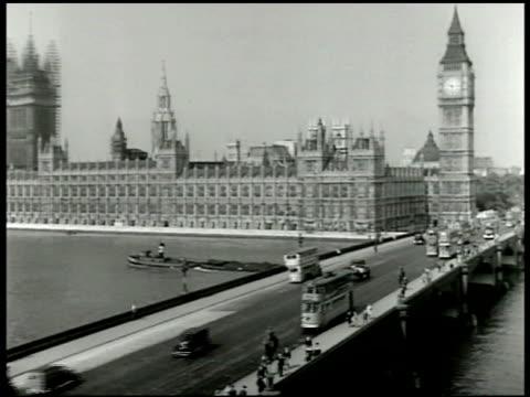 stockvideo's en b-roll-footage met houses of parliament clock tower housing big ben westminster bridge w/ traffic cars doubledecker buses fg - 1943