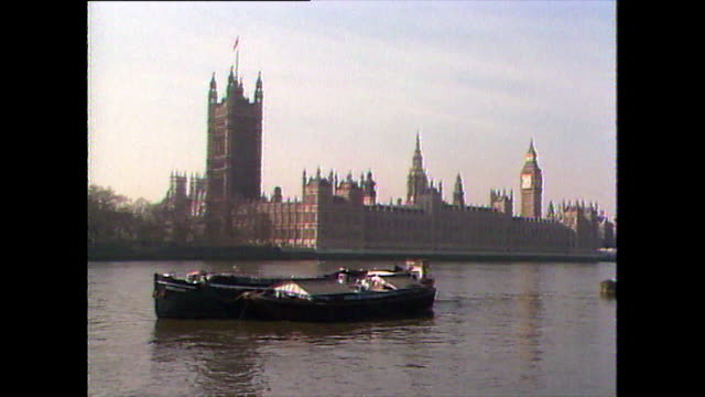 houses of parliament from river with boat; 1989 - general view stock videos & royalty-free footage