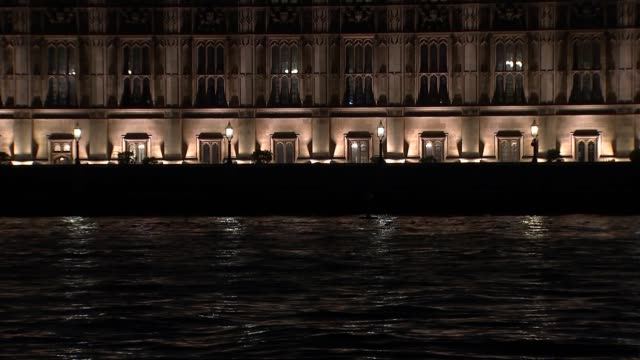 houses of parliament general views at night england london westminster windows of the houses of parliament / general views of parliament seen over... - victoria tower stock videos & royalty-free footage