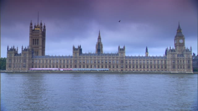 PARLIAMENT CLOUDY HD TU WS Houses of Parliament on north bank of River Thames w/ Victoria Tower Clock Tower housing Great Bell Big Ben gull bird...