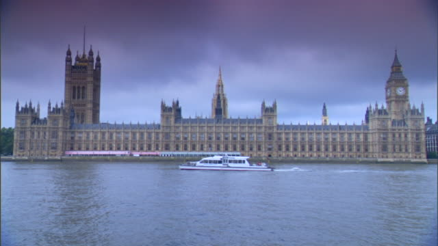 TU WS Houses of Parliament on north bank of River Thames w/ Victoria Tower Clock Tower housing Great Bell Big Ben sightseeing tourist boat through...