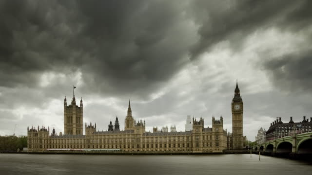 houses of parliament with storm clouds. - brexit stock videos & royalty-free footage