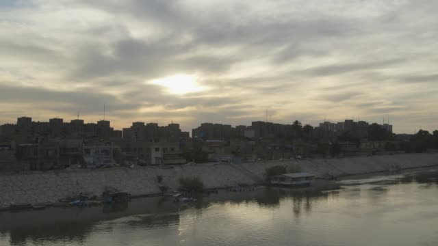 houses on baghdad river shore during sunset - baghdad stock videos & royalty-free footage