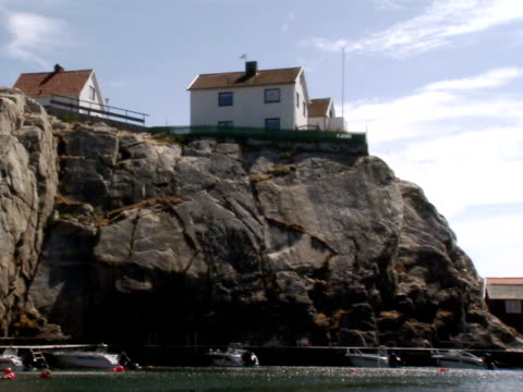 Houses on cliffs and fishing-huts by the sea Bohuslan Sweden.