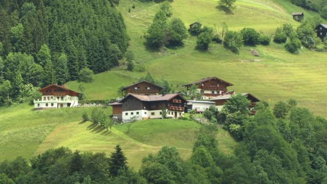 ha, ws, houses on green  hillside, grossarltal austria - traditionally austrian stock videos & royalty-free footage