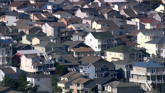 houses on ocean isle beach  - aerial view - north carolina,  dare county,  united states - north carolina beach stock videos & royalty-free footage