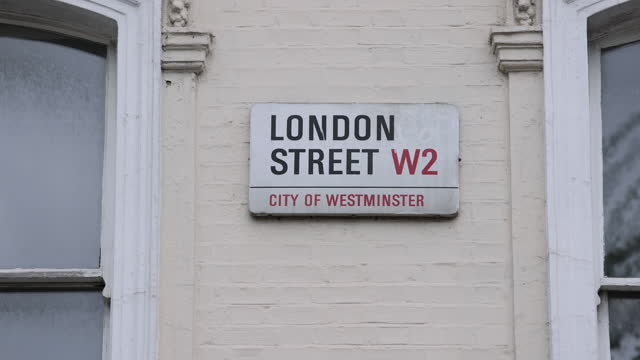houses prices in u.k., properties and estate boards in luxury area of chelsea and more suburban area of dulwich, city of london, london, england,... - street name sign stock videos & royalty-free footage