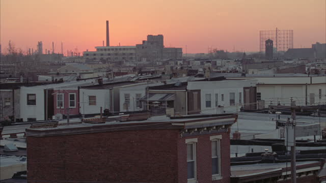 houses stand near downtown philadelphia. - sun roof stock videos & royalty-free footage