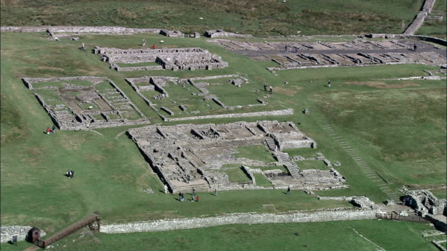 housesteads roman fort  - aerial view - england, northumberland, bardon mill, united kingdom - archaeology stock videos & royalty-free footage