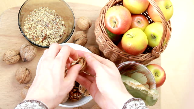 housewife cleans walnuts  from the shell - nutshell stock videos & royalty-free footage