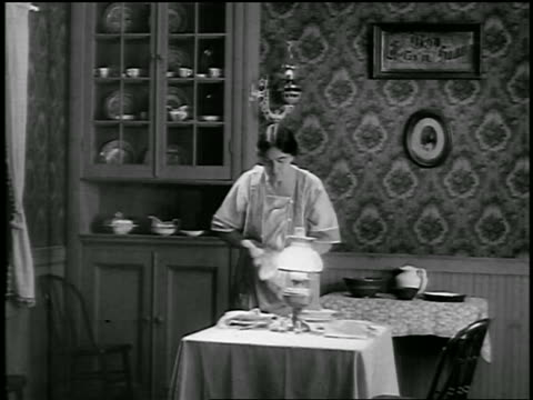 b/w 1926 housewife drying dishes in dining room / newsreel - 1926 stock videos & royalty-free footage