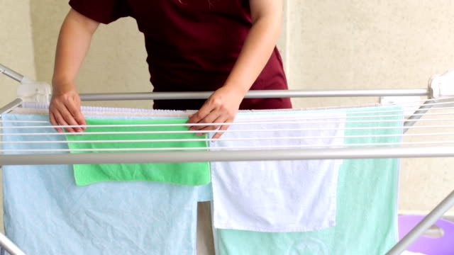 Housewife hanging up laundry