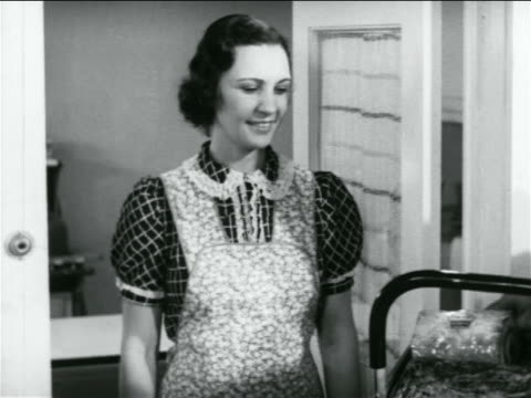 b/w 1938 housewife in apron standing in doorway smiling / industrial - 1938 stock videos and b-roll footage
