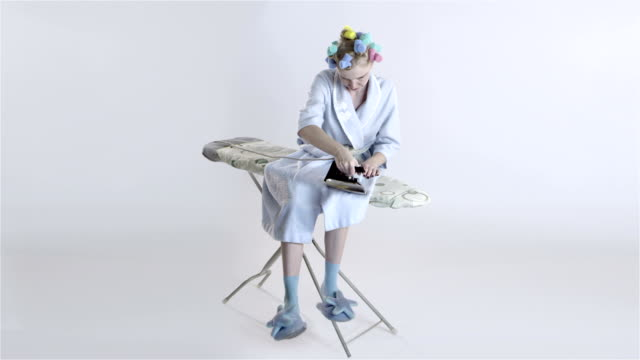 housewife in hair curlers irons herself - stereotypical housewife stock videos & royalty-free footage