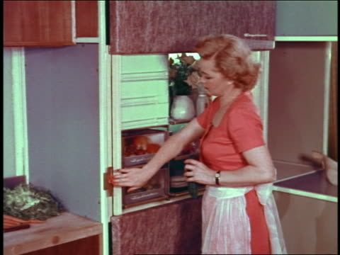 1954 housewife in kitchen activating automatically closing refrigerator + rising cutting board - 1954 stock videos & royalty-free footage