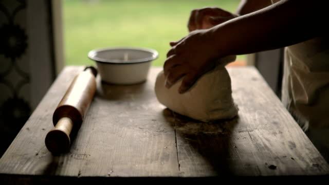 Housewife meat bread. The man enters the door