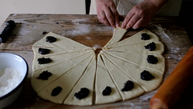 housewife roll pieces of dough with plum jam - croissant stock videos & royalty-free footage